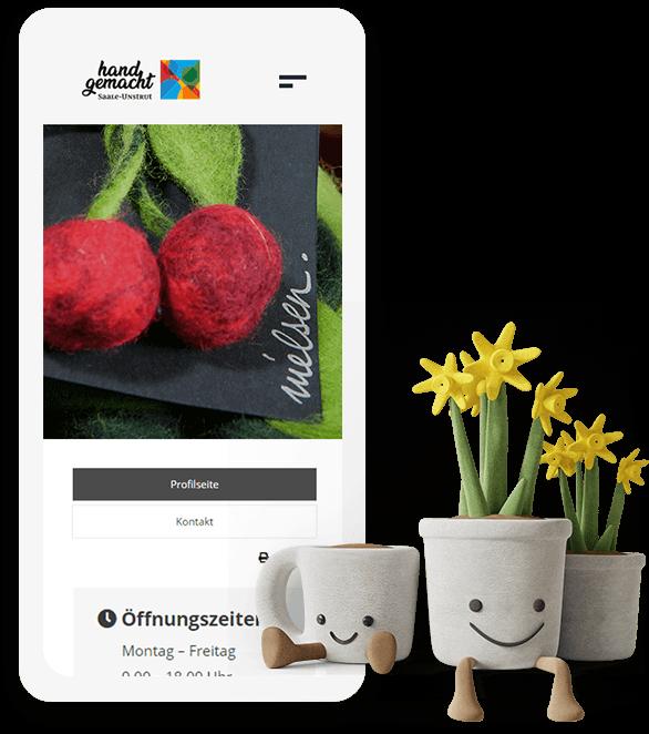 """Startbildschirm der Website von """"Saale-Unstrut Handgemacht"""" auf dem Smartphone mit Kirschen aus Filz"""